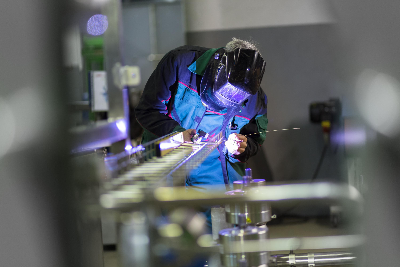 Expert performing metal fabrication process